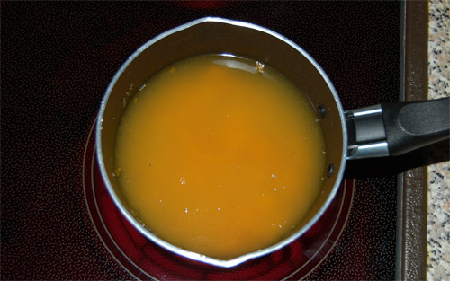 Mulled orange syrup, syrup in a saucepan
