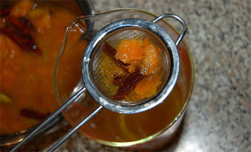 Mulled orange syrup, straining