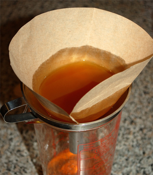 Orange bitters v.2, fine filtering through coffee filters